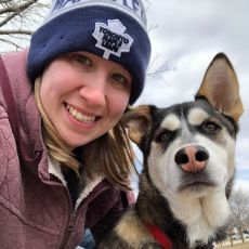 McLean Animal Hospital Registered Veterinary Technician Lisa Schumacher with dog